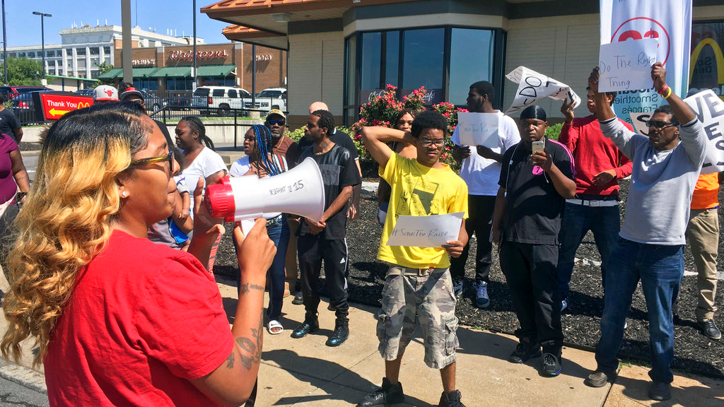 "In this Aug. 24, 2017 file photo, Gennice Mackey uses a bullhorn to lead a chant of ""Save the Raise!"" outside a McDonald's restaurant in St. Louis. Missouri is notable for having three left-leaning proposals on its 2018 ballot _ raising the minimum wage, legalizing marijuana for medical purposes and changing the congressional redistricting process so that it is potentially less partisan. (AP Photo/Jim Salter)"