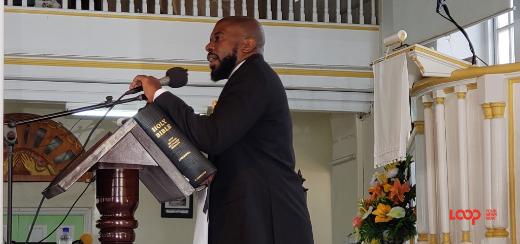 Rev. Dr. Adrian Smith at the pulpit at Calvary Moravian Church.