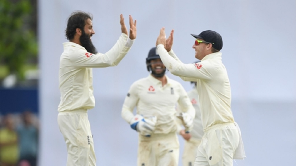 Moeen Ali celebrates with Jos Buttler.