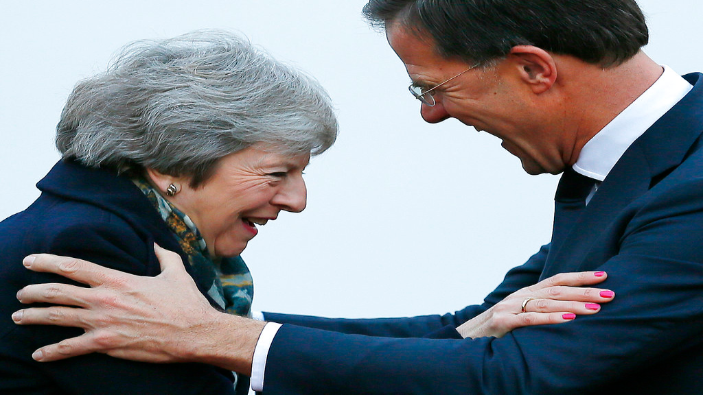 British Prime Minister Theresa May is greeted by Dutch Prime Minister Mark Rutte upon her arrival in The Hague, Netherlands, Tuesday, Dec. 11, 2018. (AP Photo/Peter Dejong)