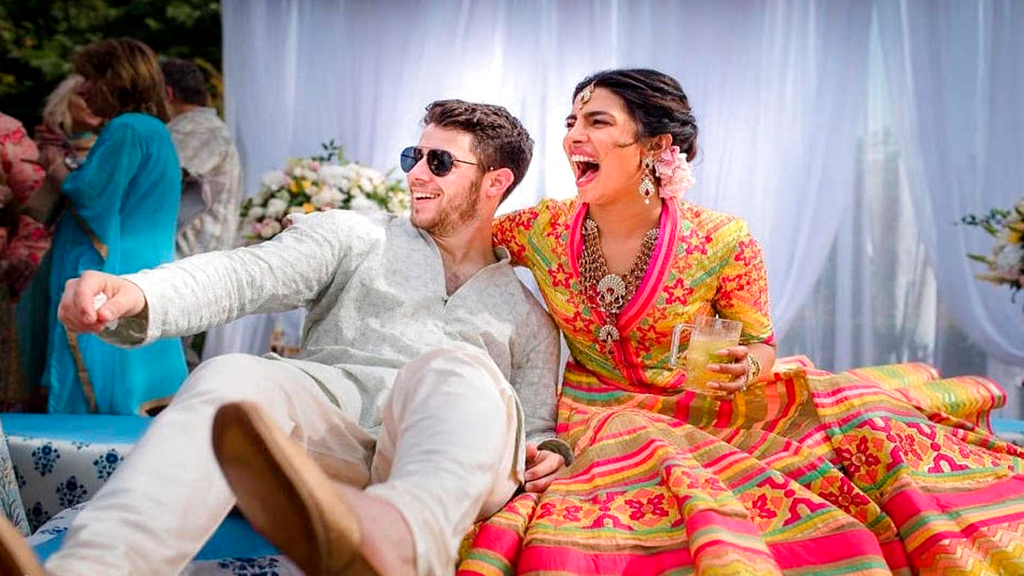 In this Friday, Nov. 30, 2018 handout photo released by Raindrop Media, Bollywood actress Priyanka Chopra and Nick Jonas celebrate during a mehendi ceremony, a day before their wedding, at Umaid Bhawan in Jodhpur, India. (Raindrop Media via AP)