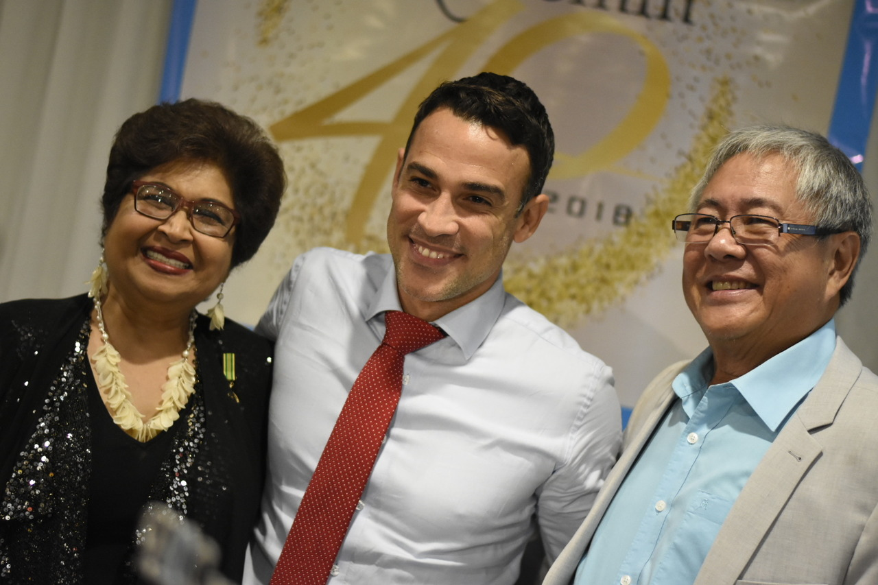 PROComm's founder and executive chairman Jean Lowrie-Chin (left) shares a moment with Digicel Jamaica CEO Justin Morin (centre) and her husband,  administrative director Hubert Chin (right) share a moment at the company's 40th anniversary celebration. (Photo: Marlon Reid)