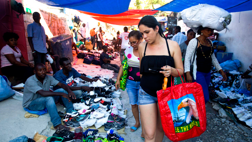 Cuban women shop at a street market in Port-au-Prince, Haiti, Thursday, Dec. 6, 2018. (AP Photo/Dieu Nalio Chery)