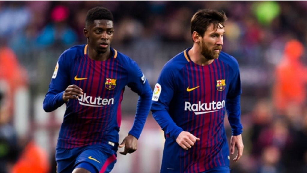 Barcelona teammates  Ousmane Dembele and Lionel Messi.