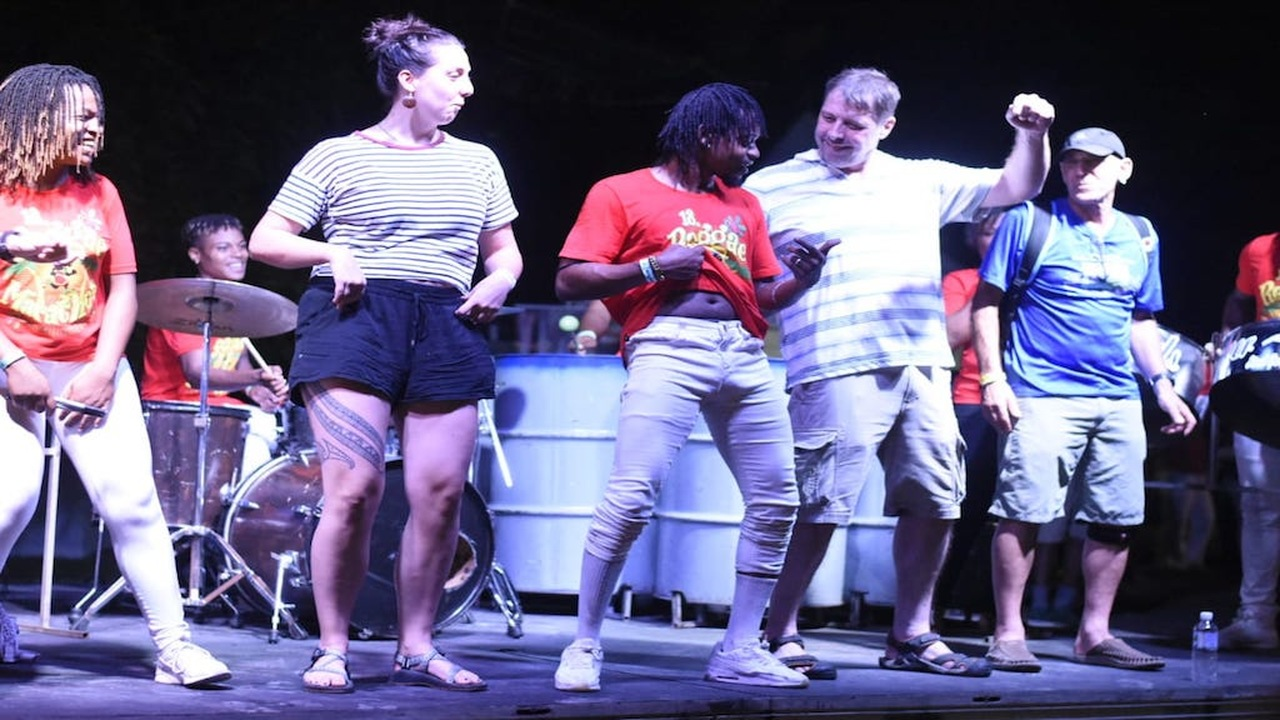 Patrons have fun on stage at the Reggae Marathon's annual Pasta Party on Saturday night. (PHOTOS: Marlon Reid)