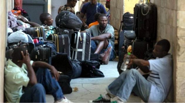 Sur cette photo, des Haïtiens se préparant à rentrer dans leur pays dans le cadre du plan de retour volontaire mis en place par le gouvernement chilien