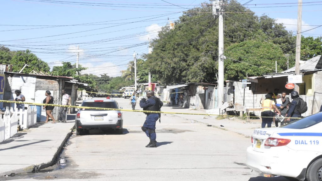 Police process the scene in Trench Town where a man was shot dead on Tuesday morning.