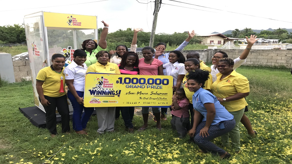 Ann-Marie Sailsman and her daughter (centre) pose with representatives of the Best Dressed Chicken after Sailsman was presented with $1 million as the grand prize winner in the company's Summer Winnings Promotion last Thursday.