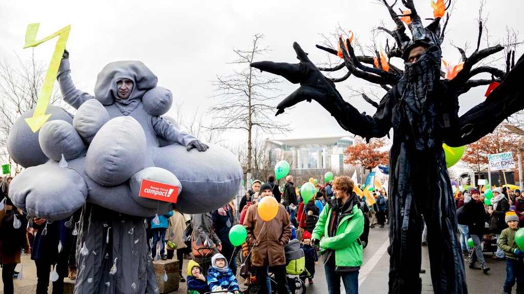 Demonstrators take part in a climate demonstration in Berlin, Germany, Saturday, Dec. 1, 2018. Thousands of people are marching in Berlin and Cologne to demand that Germany make a quick exit from coal-fired energy, a day before a U.N. climate summit opens in neighboring Poland. (Christoph Soeder/dpa via AP)