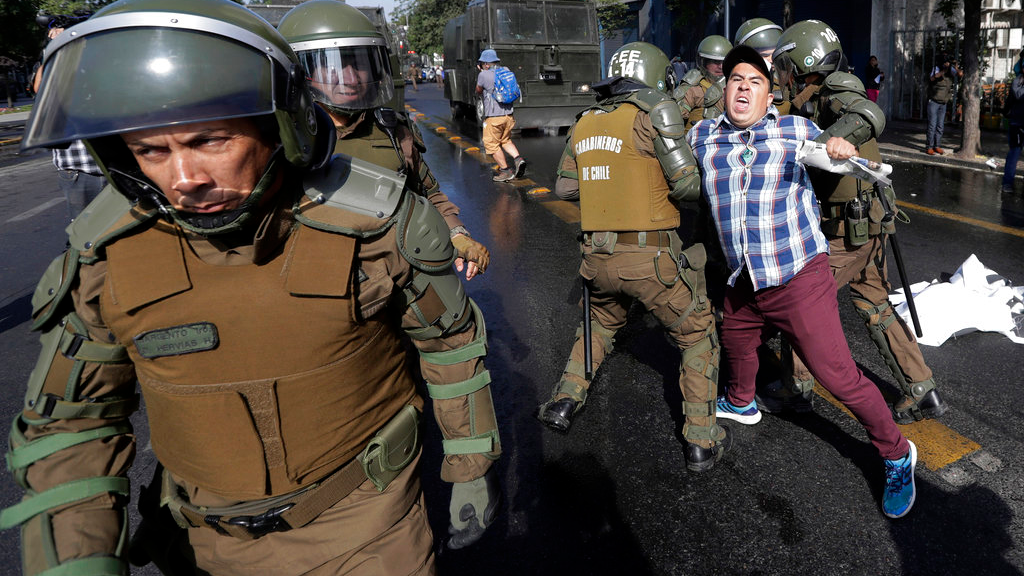 In this Jan. 16, 2018, file photo, a man is arrested during a protest against Pope Francis in Santiago, Chile. Francis' January visit was dominated by the clergy abuse scandal there, and featured unprecedented protests against a papal visit: churches were firebombed and riot police used water cannons to quell demonstrations. (AP Photo/Victor R. Caivano, File)