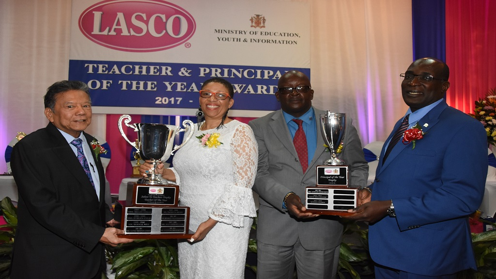 From Left: The Hon. Lascelles Chin, Founder and Executive Chairman of LASCO Affiliated Companies; Ingrid Peart-WIlmot, LASCO/MoEYI Teacher of the Year 2017/18; Howard Salmon, LASCO/MoEYI Principal of the Year 2017/18; and Senator Ruel Reid, Minister of Education, Youth & Information.
