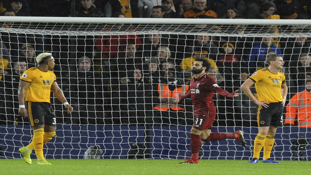 Liverpool's Mohamed Salah, centre, celebrates after scoring his side's opening goal during the English Premier League football match against Wolverhampton Wanderers at the Molineux Stadium in Wolverhampton, England, Friday, Dec. 21, 2018.
