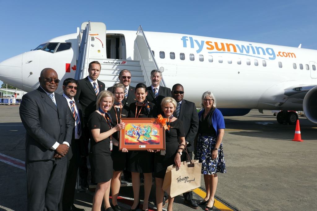The first Sunwing flight to Tobago operated by Captain Marty Neel and Captain Blair Pritchard together with First officer Ryan Isaac  and their crew are given a warm welcome at the airport.