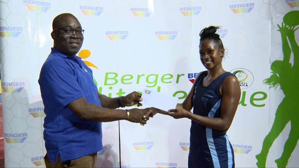 Alex Bloomfield (not associated with Berger) makes the Berger Elite League Most Valuable Player award to St Catherine Racers' Zonasha Hinds, for her performance against St James Sharpes at the Leila Robinson Courts on Saturday, December 1. St  Catherine Sharpes won 52-37.