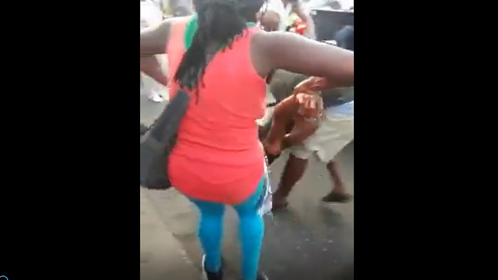 A screenshot from a video of persons assisting a victim of a stabbing incident in Ocho Rios town centre in St Ann on Christmas morning.