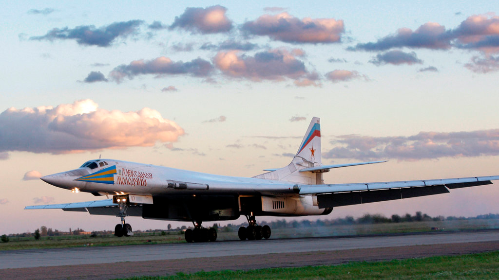 FILE - In this file photo taken on Friday, Sept. 12, 2008, Russia's strategic bomber Tu-160 or White Swan, the largest supersonic bomber in the world, lands at Engels Air Base near Saratov, about 700 kilometers (450 miles) southeast of Moscow, Russia. The Russian military says two of its nuclear-capable strategic bombers have arrived in Venezuela, a deployment that comes amid soaring Russia-U.S. tensions. (AP Photo/Misha Japaridze, File)