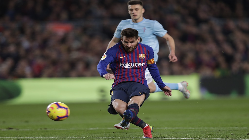 Barcelona's Lionel Messi kicks the ball to score during the Spanish La Liga football match aagainst Celta Vigo at the Camp Nou stadium in Barcelona, Spain, Saturday, Dec. 22, 2018.