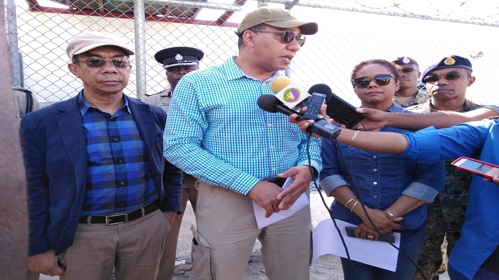 Prime Minister Andrew Holness fielding questions at the end of a three-leg tour of detention centres under the states of emergency across the island, in Montego Bay on Saturday. To his left and right, respectively, are Security Minister, Dr Horace Chang and Attorney General, Marlene Malahoo-Forte; with JDF Chief of Staff, Major General Rocky Meade, at the extreme right (background).