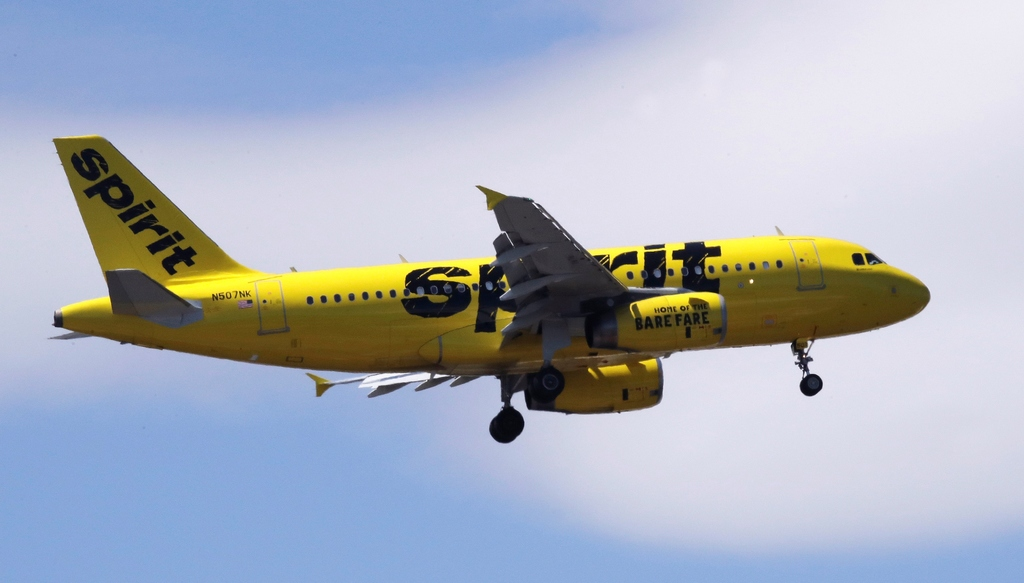 This May 24, 2018, file photo shows a Spirit Airlines passenger jet plane, an Airbus 319 model, approaching Logan Airport in Boston. Spirit Airlines tops the latest ratings for on-time flights, a stunning turnaround for a discount carrier that consistently ranked as the tardiest airline in America three years ago.  (AP Photo/Charles Krupa, File)