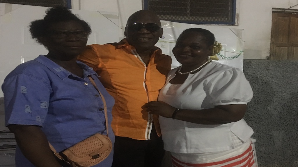 Reggae artiste George Nooks poses with operations manager, Delfreda Cammock-Thorpe, and supervisor Morelene Moncrieffe of the Golden Age Home in Vineyard Town during a Christmas treat.