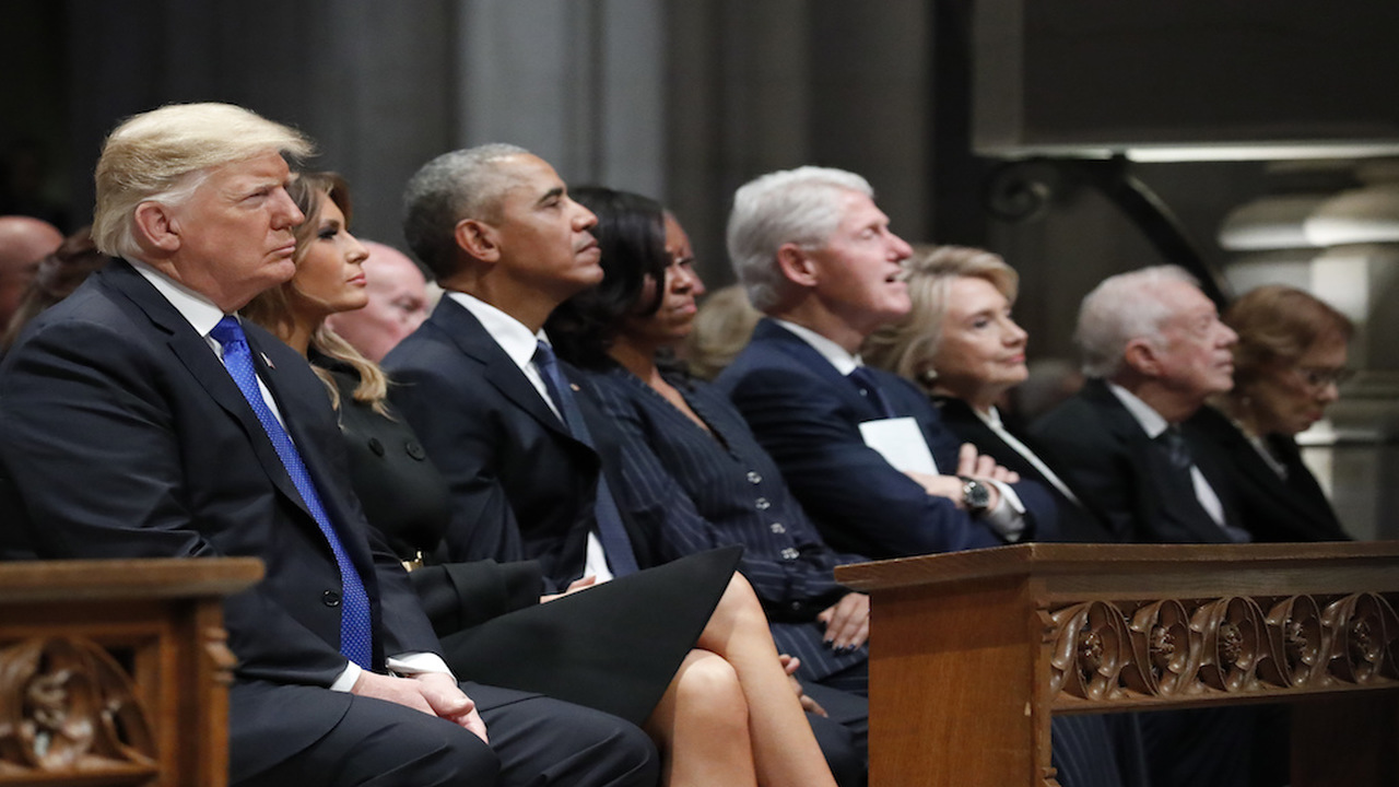 From left, President Donald Trump, first lady Melania Trump, former President Barack Obama, Michelle Obama, former President Bill Clinton, former Secretary of State Hillary Clinton, and former President Jimmy Carter listen as former President George W. Bush speaks during a State Funeral at the National Cathedral, Wednesday, Dec. 5, 2018, in Washington, for former President George H.W. Bush.(AP Photo/Alex Brandon, Pool)
