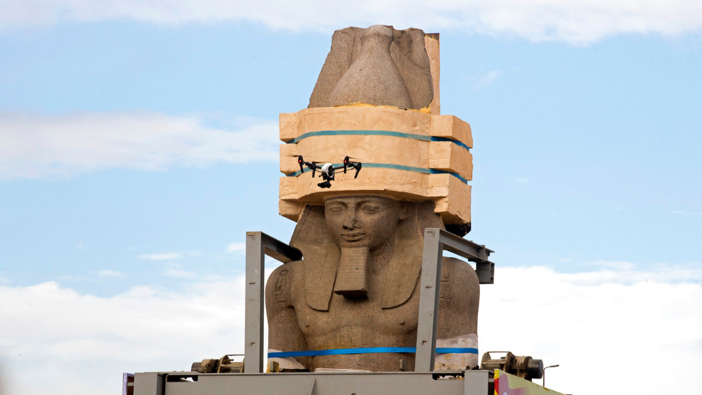 FILE - In this Jan. 25, 2018 file photo, a drone flies around a giant statue of the pharaoh Ramses II as it is relocated to the Grand Egyptian Museum, in Cairo, Egypt. (AP Photo/Amr Nabil, File)