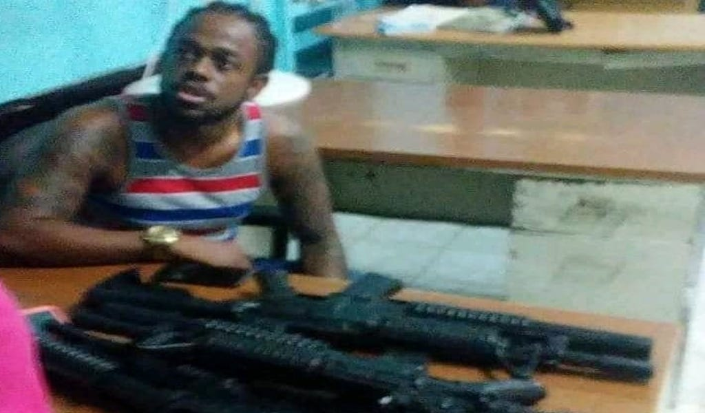 Kalado pictured with what police say are fake guns.