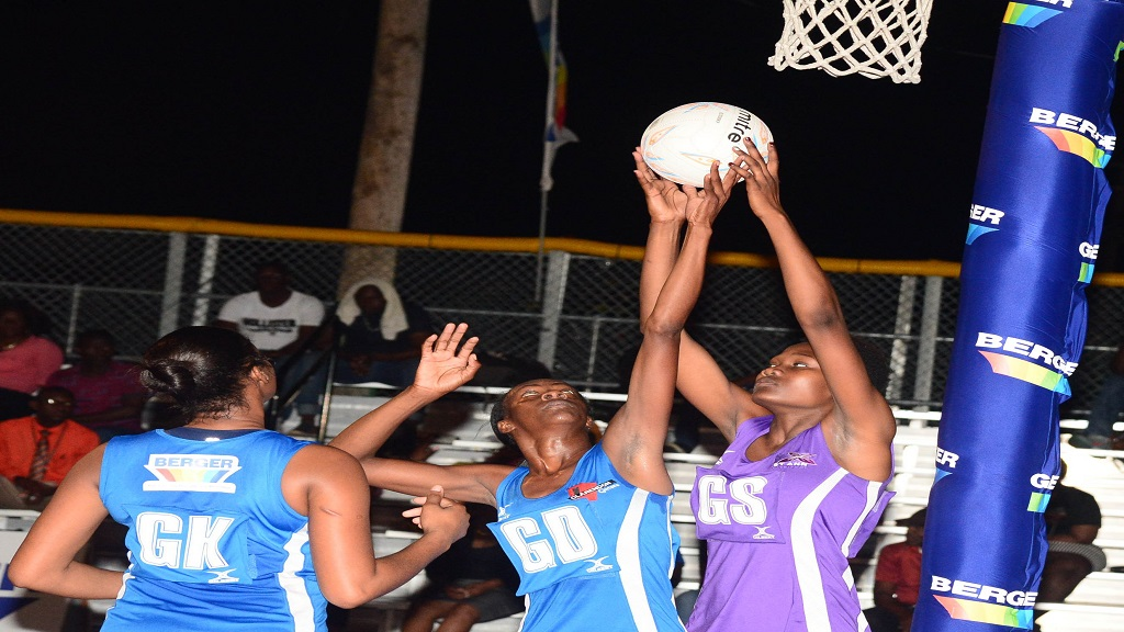 Clarendon Gaters' Petal Smith (centre) challenging St Ann Orchids' for a rebound in her regular Goal Defence role during an earlier Berger Elite League netball match at Leila Robinson Courts.