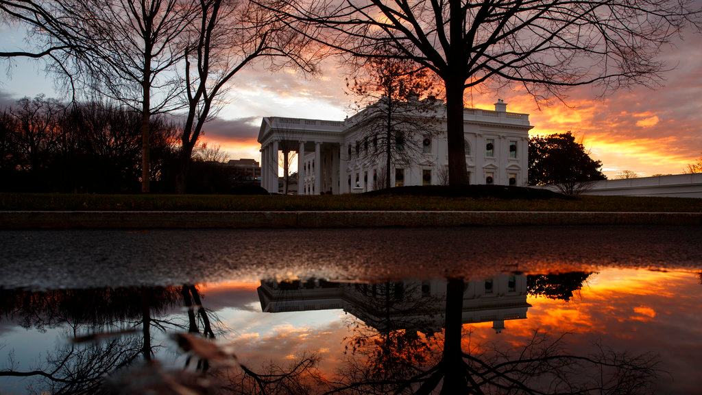 The sun rises behind the White House in Washington, Saturday, Dec. 22, 2018. Hundreds of thousands of federal workers faced a partial government shutdown early Saturday after Democrats refused to meet President Donald Trump's demands for $5 billion to start erecting a border wall with Mexico. (AP Photo/Carolyn Kaster)