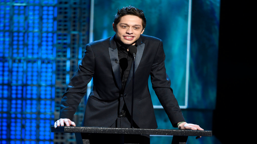 FILE - In this March 14, 2015, file photo, Pete Davidson speaks at a Comedy Central Roast at Sony Pictures Studios in Culver City, Calif. Davidson is breaking his silence in an Instagram post following the short-lived engagement with Ariana Grande. Davidson says he's been getting bullied online and in public for nine months. (Photo by Chris Pizzello/Invision/AP, File)