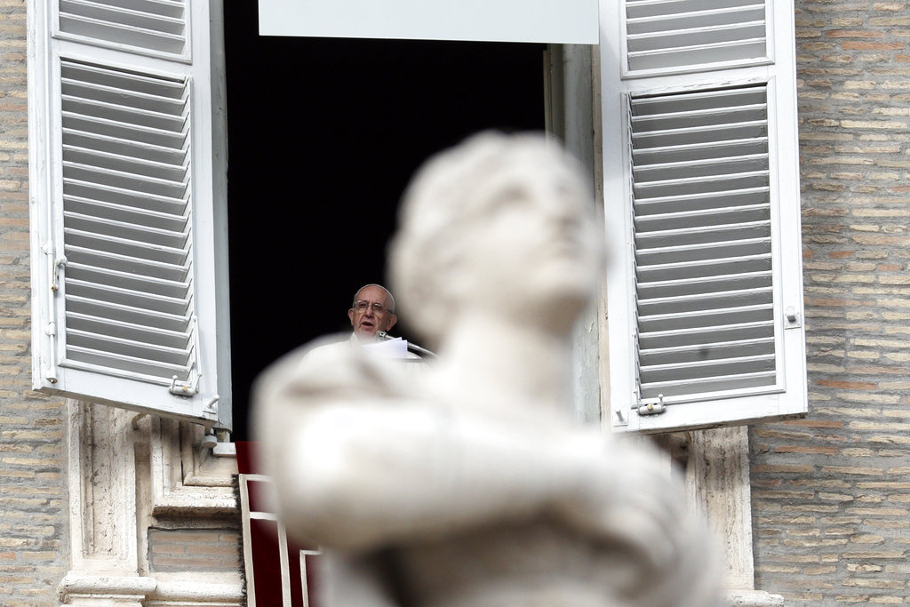 Pope Francis delivers his message during the Angelus noon prayer in St. Peter's Square, at the Vatican, Sunday, Dec. 16, 2018. (AP Photo/Gregorio Borgia)