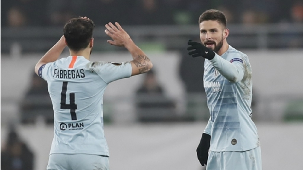Olivier Giroud celebrates scoring with Cesc Febregas.