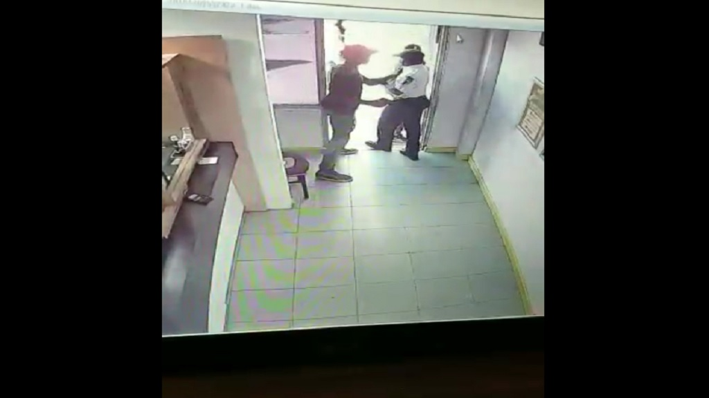 A screenshot from CCTV footage of the fatal attack on a security guard in Portmore, St Catherine last week.