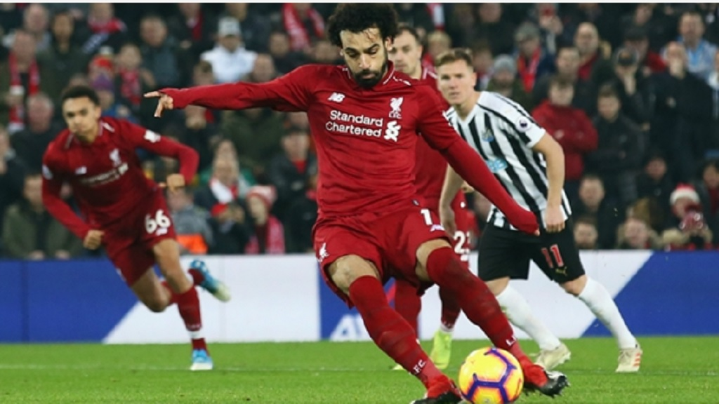 Liverpool star Mohamed Salah scores against Newcastle United.