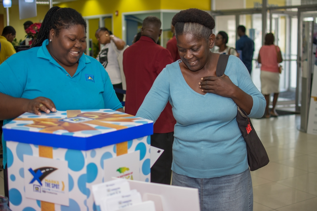 Claudette Stephenson (right), JN Member chooses her gift while Chevanese Peters, programmes coordinator, JN Foundation looks on.