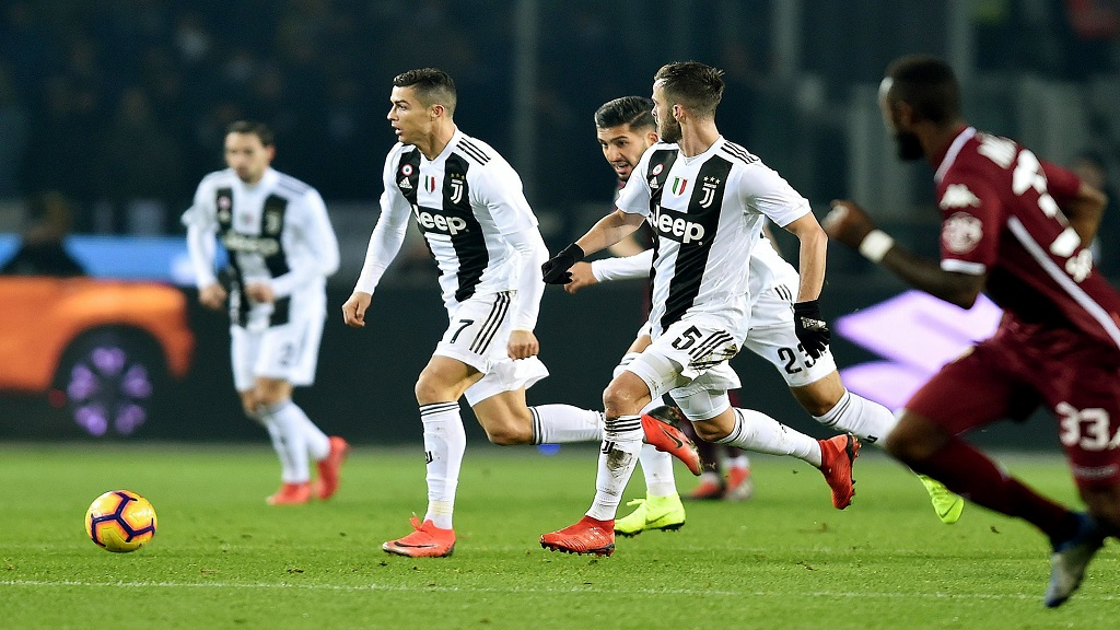 Juventus' Cristiano Ronaldo controls the ball during the Italian Serie A football match against Torino FC at the Olimpico stadium in Turin, Italy, Saturday Dec. 15, 2018.