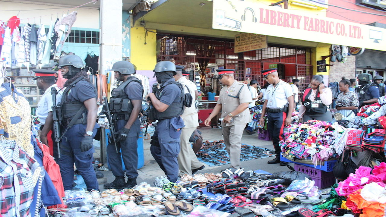 Police officers tour the downtown Kingston market district on Thursday. (PHOTOS: Julian Richardson)