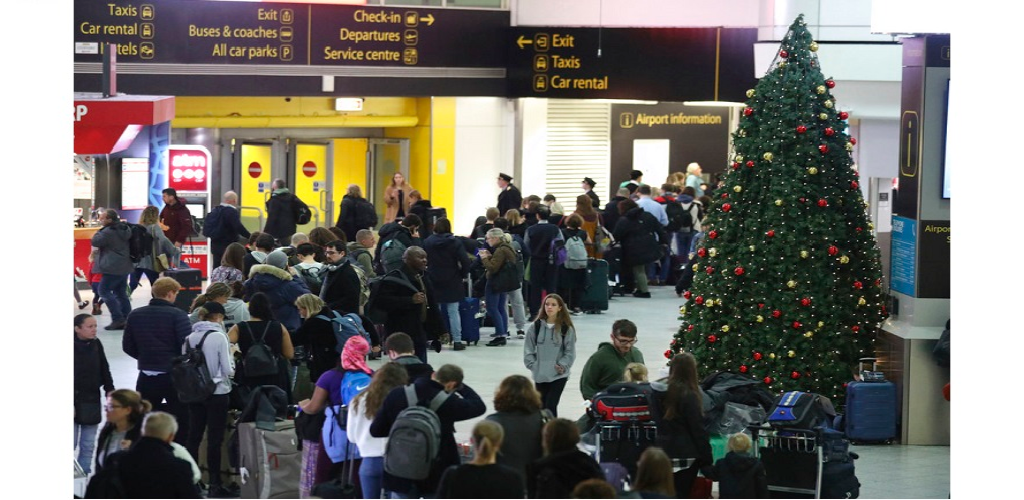 Passengers at Gatwick airport wait for their flights following the delays and cancellations brought on by drone sightings near the airfield, in London, Friday Dec. 21, 2018. New drone sightings Friday caused fresh chaos for holiday travelers at London's Gatwick Airport.