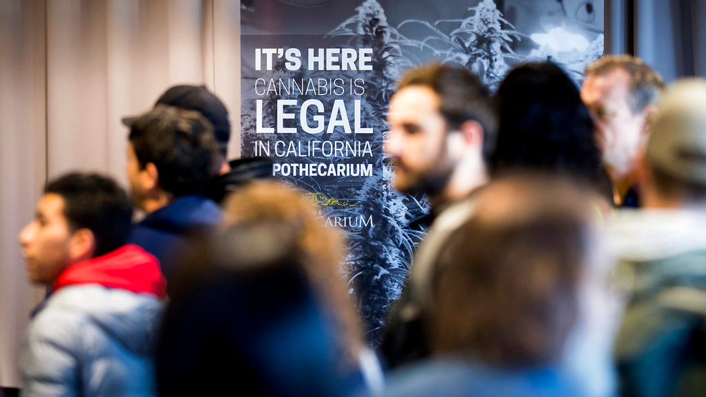 In this Jan. 6, 2018, file photo, customers line up to buy cannabis at The Apothecarium during the store's first day of recreational marijuana sales in San Francisco. California became America's largest legal marketplace, while Canada became the second and largest country with nationwide legal recreational marijuana. (AP Photo/Noah Berger,File)
