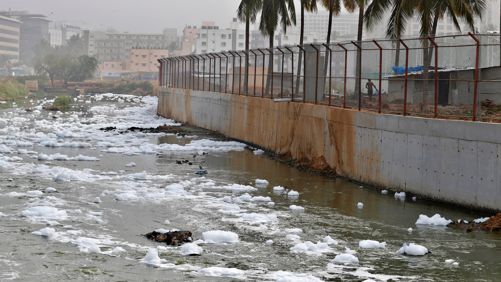 In this Monday, Dec. 10, 2018 photo toxic froth from industrial pollution floats on Bellundur Lake in Bangalore, India.  (AP Photo/Aijaz Rahi)