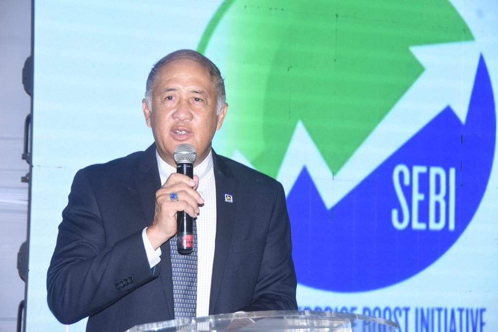 Parris Lyew-Ayee, chairman of the JN Foundation addressing the close-out ceremony of the Social Enterprise Boost Initiative (SEBI), a project of the JN Foundation and the United States Agency for International Development (USAID), at the Terra Nova All Suite Hotel in Kingston, recently.