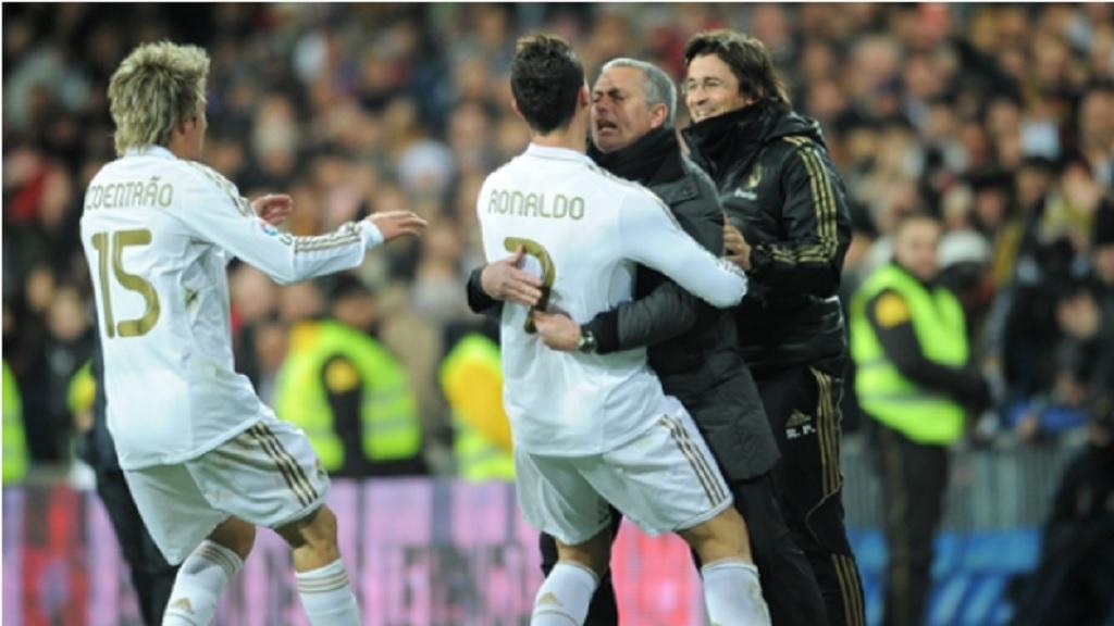Jose Mourinho celebrates with Cristiano Ronaldo at Real Madrid.