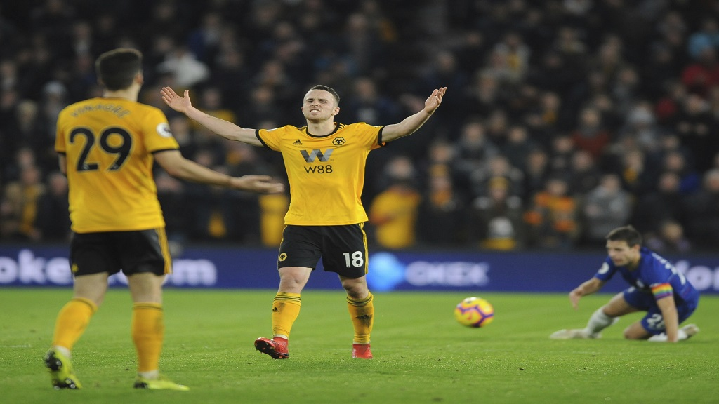Wolverhampton's Diogo Jota, centre, reacts during the English Premier League football match against  Chelsea at the Molineux Stadium in Wolverhampton, England, Wednesday, Dec. 5, 2018.