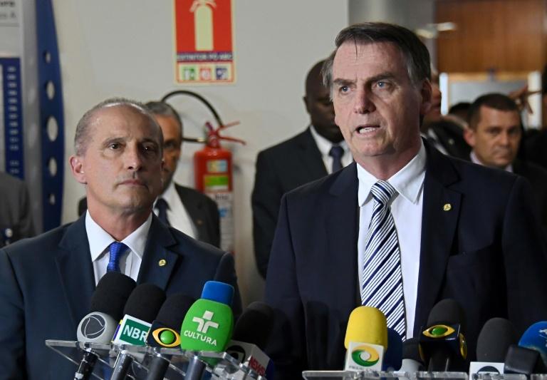 Le président élu Jair Bolsonaro (à droite) et son futur chef de cabinet Onyx Lorenzoni, le 20 novembre 2018 à Brasilia