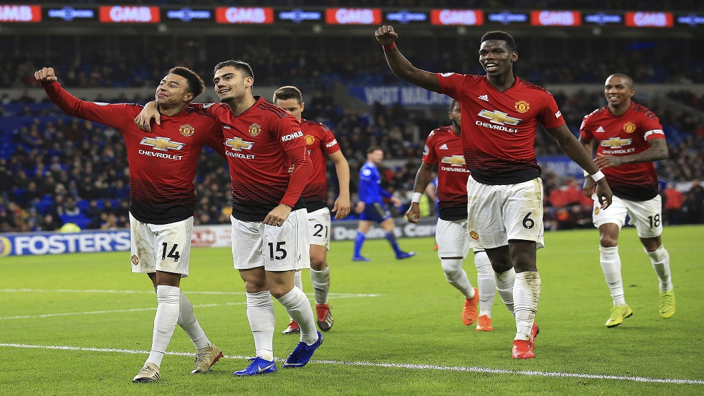 Manchester United midfielder Jesse Lingard, left, celebrates his goal against Cardiff City at the Cardiff City Stadium in Cardiff, Wales, Saturday Dec. 22, 2018.