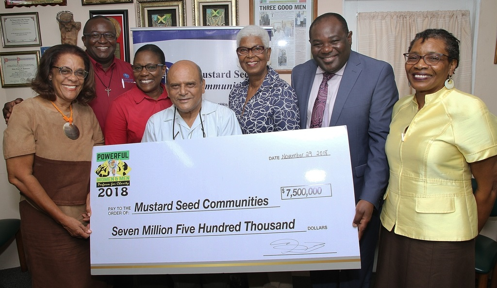 Members of the Planning Committee of the Powerful Women & Men Perform for Charity show handed over a symbolic cheque for $7.5 million as proceeds from the 2018 event to executives of the Mustard Seed Communities recently.