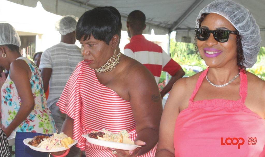 (left) Sharon Bellamy serving food at the Boxing Day party.
