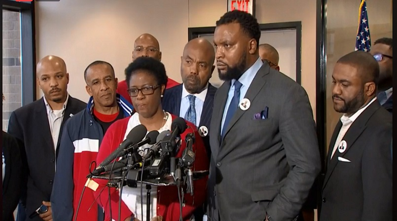 Bertrum (second left) and Allison Jean (third left) speak at a press conference following Amber Guyger being indicted for their son Botham's murder.