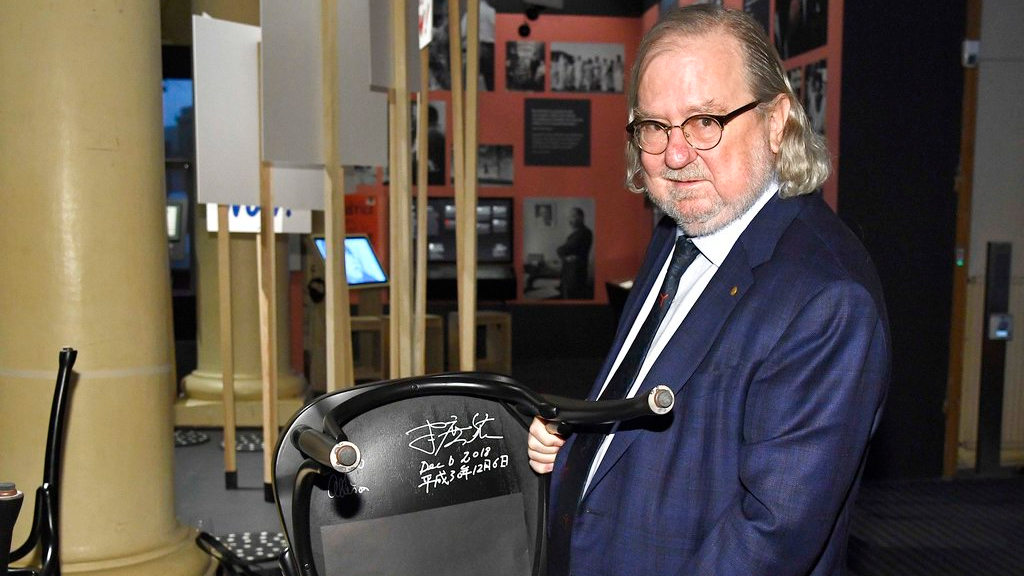 The 2018 Nobel Physiology or Medicine laureate, Professor James P. Allison poses during the traditional Nobel Chair Signing ceremony at the Nobel Museum in Stockholm, Sweden, on Thursday Dec. 6, 2018. (Claudio Bresciani/TT via AP)