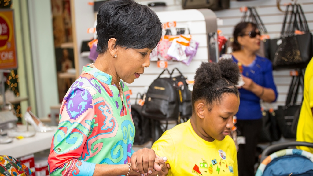 Mrs Sharon Rowley, wife of Prime Minister Dr Keith Rowley was on hand to help the children select their shoes.